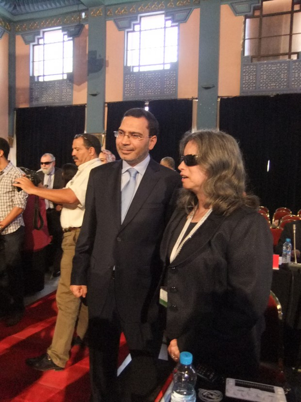 Mustapha Khalfi (left), the Moroccan Minister of Communication congratulating Melanie Brunson (right), American Council of the Blind. (Photo Credit: Catherine Saez, IP-Watch)