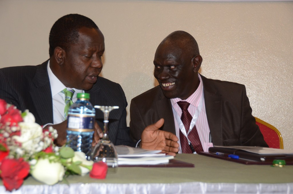 Kenya's Education Cabinet Secretary Dr. Fred Matiang'i consulting with the Director National Commission for Science and Technology and Innovation (NACOSTI) Dr. Moses Rugutt at Laico Regency Hotel, Nairobi during the official opening of Science, Technology and Innovation whose theme was 'Unleashing Innovation Clusters, Hubs and Parks as Drivers of Africa's Transformation', 2 December 2015